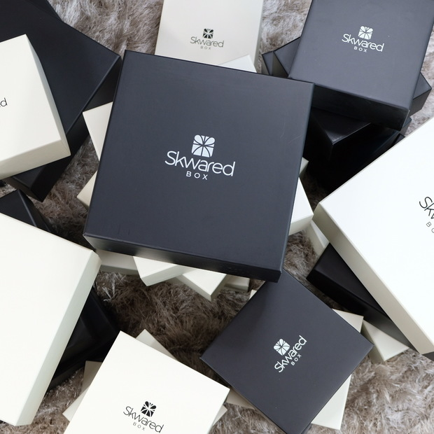 Multiple gift boxes with Skwared Box logo