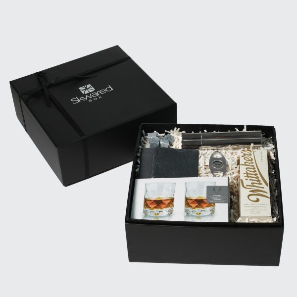 Gift box with whiskey and cigar products
